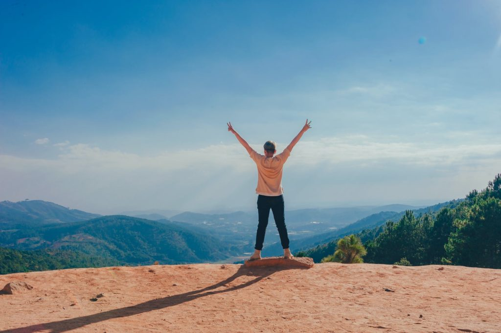 A successful person on top of a mountain